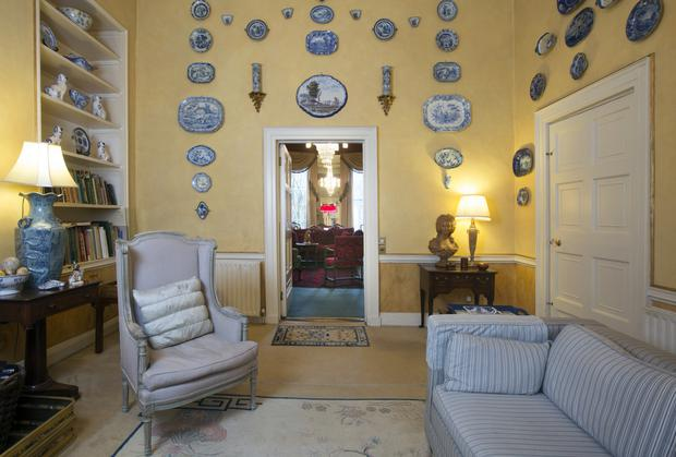 China restorer Desiree Shortt has painted one of her three enormous reception rooms in yellow, and decorated the walls with over 100 pieces of blue and white porcelain
