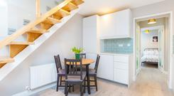 The open-plan living area at 1 Fingal Street in Dublin 8 with a minimalist staircase and raised ceiling