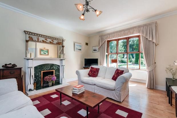 Living room with maple floors and bay window