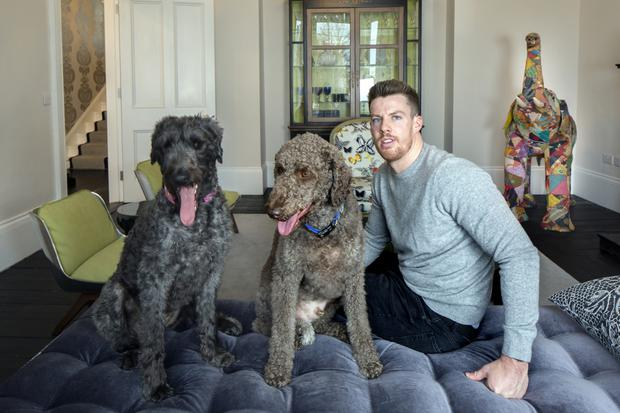 Adam White-Parsons with his dogs Zeus and Lola at 7 Eden Park, Glasthule, Co Dublin