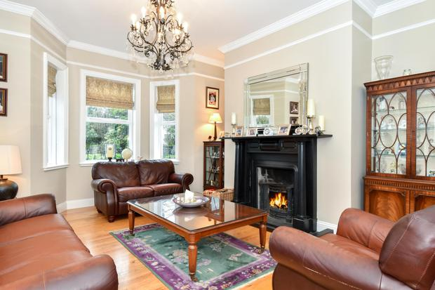 The family room with a fireplace and bay window