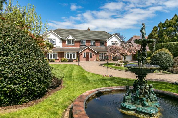 An ornate fountain and pond make for a grand entrance to Fairacre