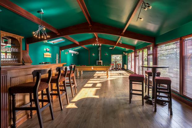 The bar and games room which has a swimming pool stored beneath it