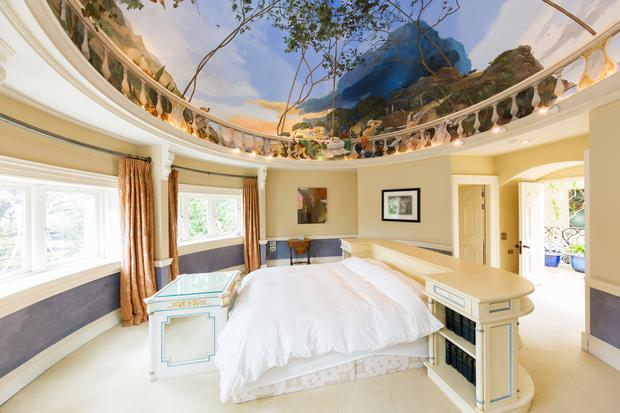 The master bedroom at Embassy House comes with a domed, painted ceiling