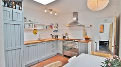 The kitchen with terracotta tiled floor is in the rear extension at No61 West Road