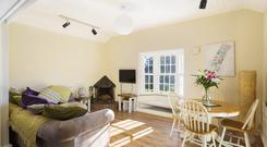 The living room is open plan to the kitchen at Glenlion Lodge, Howth,