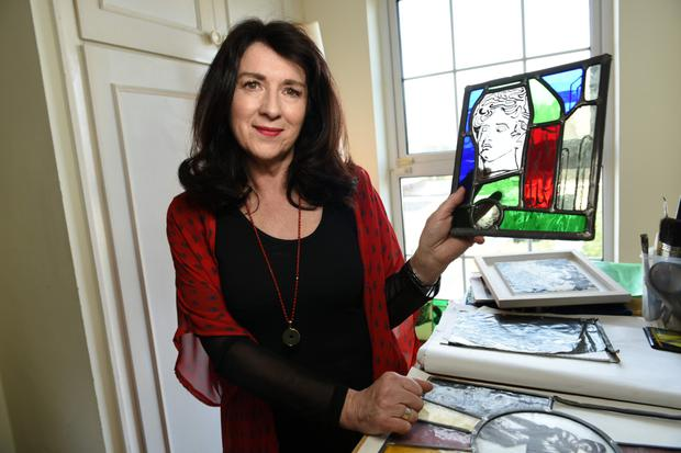 Anne Marie Hayes with a piece of her stained glass work