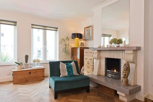 The living room with a parquet floor and a fireplace