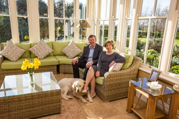 Morgan and Phyl Doyle with golden retriever Fannie, at their home, Garnaman, near Kells, Co Kilkenny. The couple employed an architect to design their new build as a Georgian rectory-style house