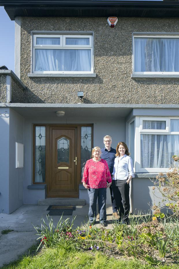 Ann Gilsenan with Ciarán Ferrie and Michelle Moor outside her home in Clondalkin