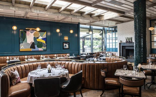 Need inspo? The Grill Room at The River Club at Cork's River Lee Hotel is just the ticket with Art Deco touches that sit beautifully alongside a deep, glossy wall treatment and contrasting leather banquettes