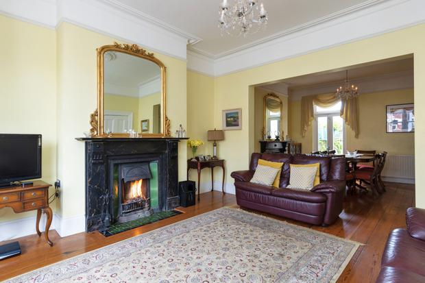 The lounge has a marble fireplace and is linked to the dining room