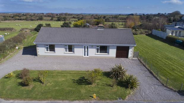This spacious bungalow has two reception rooms - a lounge and dining room
