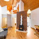 The living room has a brick fireplace with a gas-fitted stove