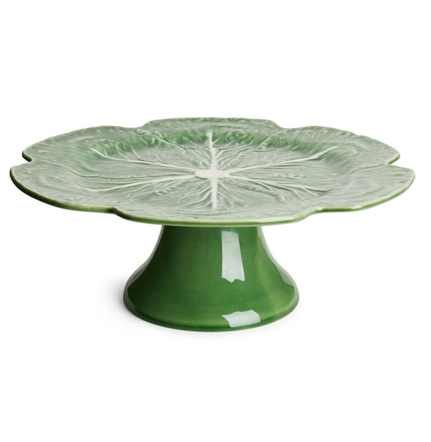 Vintage ceramics are trendy again, like this cabbage leaf cake stand; bordalopinhero.com, €47