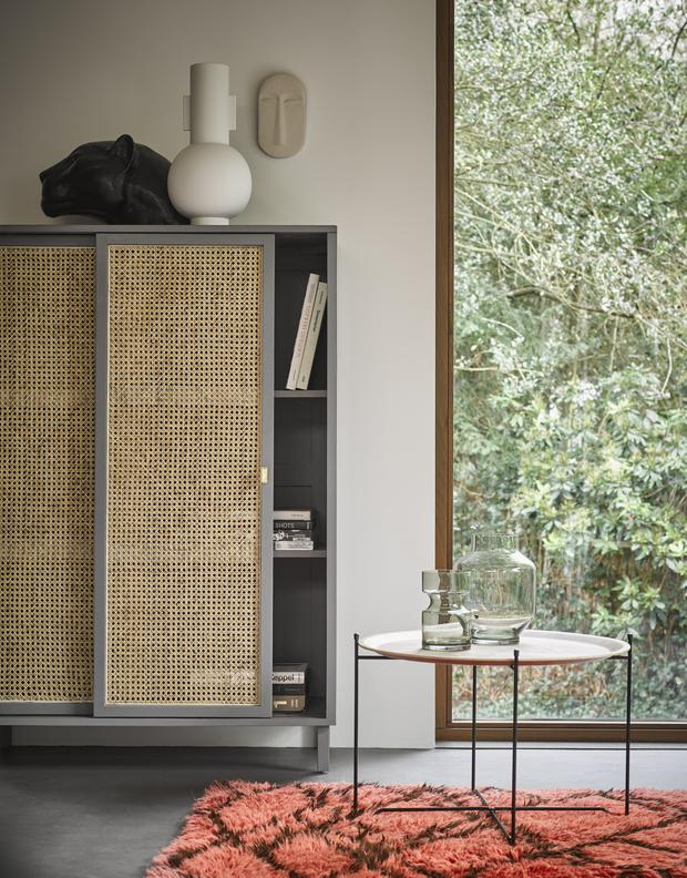 Cane's repertoire has expanded. This cabinet from HK Living at livingandcompany.com, is a case in point. Plus, it offers storage and sleek design — win-win.
