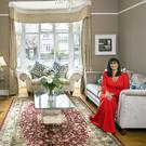 "Entrepreneur Rhoda McDonagh in her drawing room where she loves to light real fires. The sofas are from Caseys in Cork, the coffee table was bought in Castleisland, Co Kerry, and the harp is her own. ""I used to play for the guests in Dromoland and Adare"", she explains. Photo: Tony Gavin"