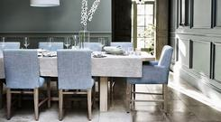 Blue works brilliantly here with olive paint work, the natural tones on the stone floor and on the Arundel dining table, €2,040; neptune.com