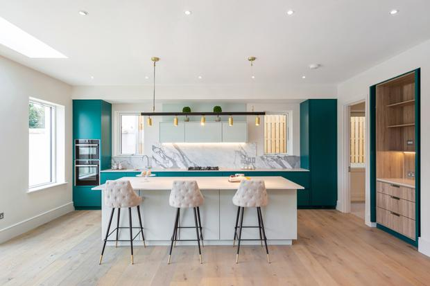 The Italian job: The open-plan kitchen/diner/living area spans the width of the house with jade-coloured handcrafted kitchen units with quartz countertops along one wall