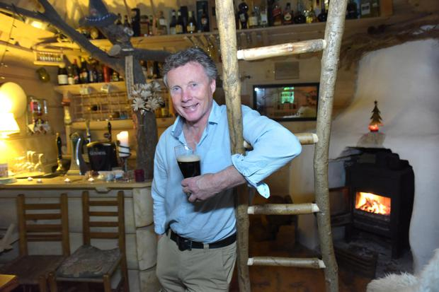 Hooting time: Derek McCarthy has a pub with Guinness on tap set up in a shed in his garden in Annacotty, Co Limerick. Photo: Bryan Meade