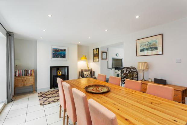 The basement is given over to a large dining room/kitchen that seats up to 10