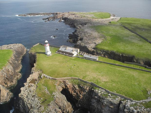 The pair of cottages on Rathlin O'Birne island are being sold together with seven acres of land