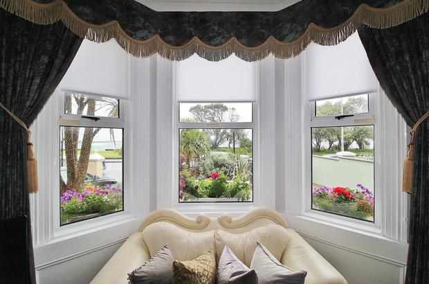 The main livingroom's bay window views of the seafront