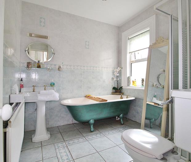 A bathroom with stand alone tub