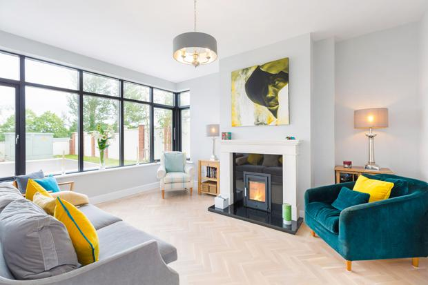 No17 Silverton in Rathfarnham, Dublin 16, which has a feature fireplace with a solid fuel burner in the box bay living room (pictured), is on the market for €640,000