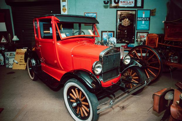 The Model T which has been repainted a bright red