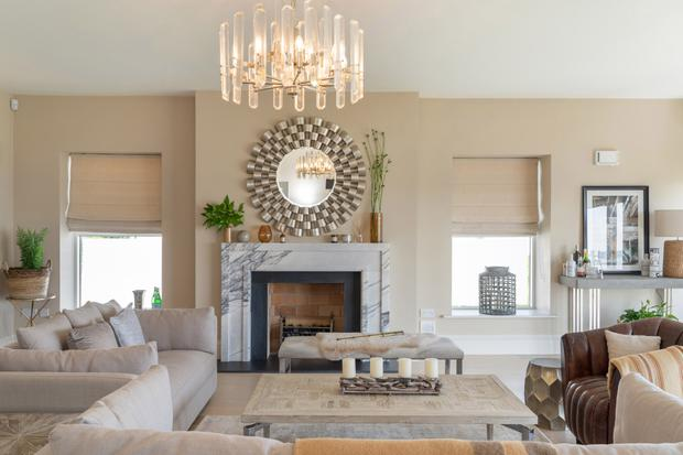 Hamptons look: The front reception room with its deco marble fireplace