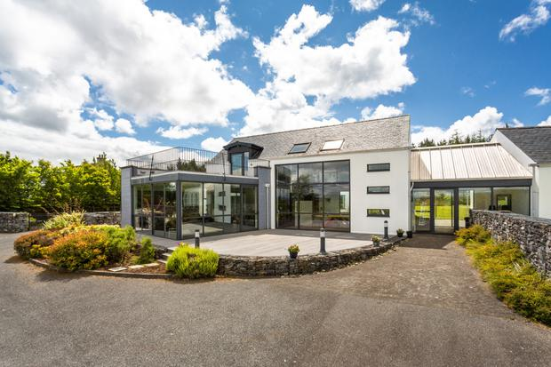 The glass fronted house enjoys views over Lough Swilly, Rathmullan and Buncrana