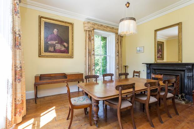 The dual-aspect dining room with an original fireplace