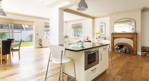 Park right: The open-plan kitchen living space with restored chimney piece