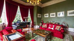 The drawing room of Rathbrist House in Tallanstown, Dundalk, Co Louth, features ornate cornicing and recessed sash windows