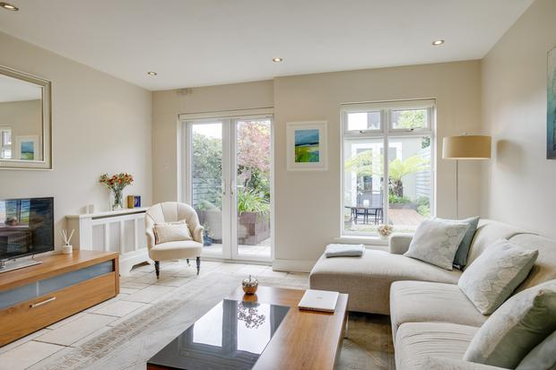 You reach the garden through French doors in the extended living/dining room
