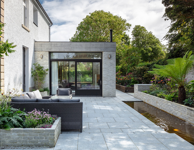 The side courtyard with water feature
