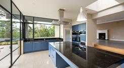 Fore: the kitchen has full-height corner windows overlooking Castleknock golf course