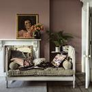 Faded glamour and a feminine hue liberally applied — could this be the perfect living room? Farrow & Ball's Sulking Room Pink is entry-level darkened pastel. Photo: James Merrell