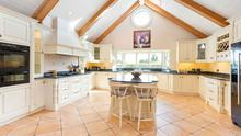 The kitchen features a vaulted ceiling