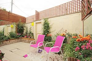 Planters containing flowers add a splash of colour in the courtyard