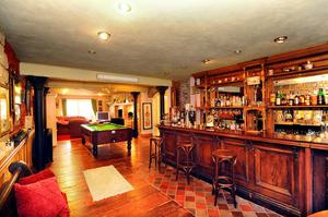 The family room with fully equipped bar.