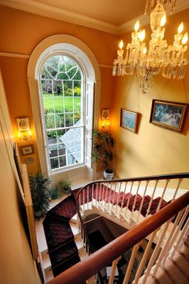The staircase is dominated by a sash window.