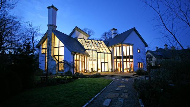 A night time exterior shot of 6 the Demesne in Adare Manor