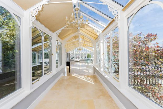 The lit corridor to the conservatory