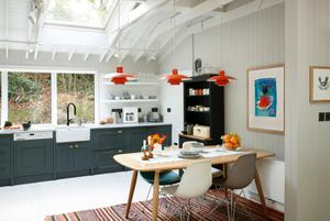 The bright 1960s-style cabin kitchen