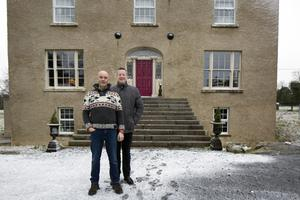 Ronan and Charles in front of the house, part of which was a tower house dating from the 17th Century, and part of which was a gentleman's residence dating from 1804. All the windows are new, and they had the facade completely restored. Photo: Tony Gavin