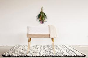 Hug it out, €399: Featuring organic materials and sustainably made in Ireland, The Hugg bedside crib also converts to a desk and bench once baby outgrows it; bababou.com