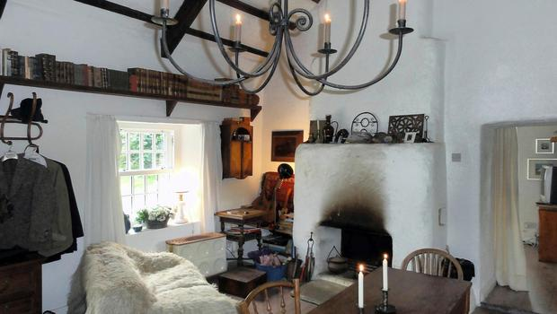 The living area has oak beams and a traditional fireplace