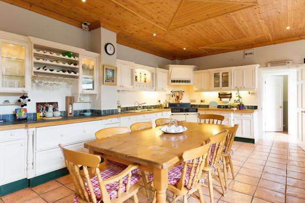 A kitchen with panelled ceiling